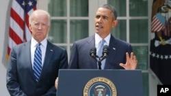 Başkan Obama, Suriye'ye karşı verilecek tepki konusunda Beyaz Saray'da yaptığı açıklamayı yanında yardımcısı Joe Biden'la birlikte yaptı