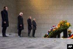 France's President Emmanuel Macron and German President Frank-Walter Steinmeier attend a wreath laying ceremony at the Central Memorial for the Victims of War and Dictatorship in Berlin, Nov. 18, 2018.