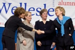 FILE - From left, Wellesley College President Diana Chapman Walsh, former Secretary of State Madeline Albright, U.S. Court of Appeals Judge Susan P. Graber and then-Sen. Hillary Clinton gather onstage following a panel discussion before alumnae at Wellesl