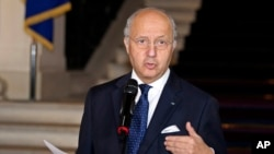 "FILE - French Foreign Minister Laurent Fabius, describing a world where floods, desertification and droughts will intensify conflicts, calls climate change ""a threat to peace."""