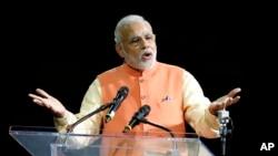 PM India Narendra Modi memberi sambutan di Madison Square Garden, Senin (29/9).