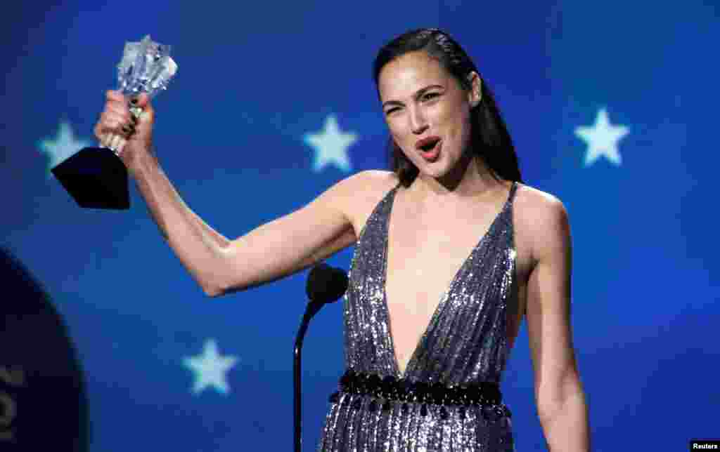 Wonder Woman actress Gal Gadot collects her #SeeHer award at last night's Critics' Choice Awards.