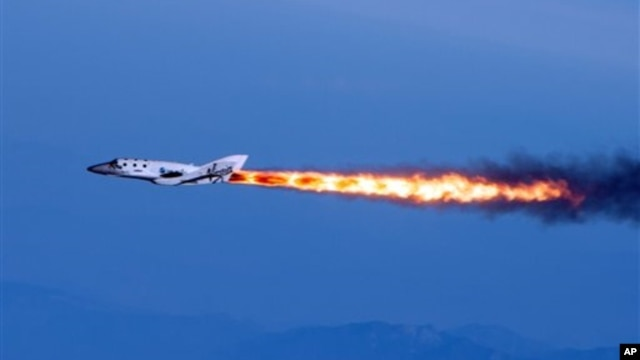 SpaceShipTwo under rocket power after being dropped from its 'mothership,' April 29, 2013 (Virgin Galactic photo)
