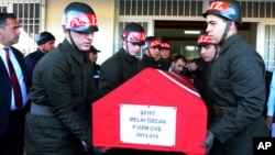Soldiers at the airport in Gaziantep, Turkey, carry the coffin of a Turkish soldier killed in what the Turkish military said was a pre-dawn airstrike carried out by Syrian government forces, Nov. 24, 2016.