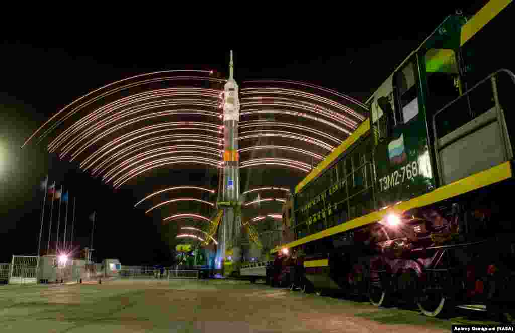 The gantry arms close around the Soyuz TMA-20M spacecraft to secure the rocket, as seen in this long exposure photograph at launch pad 1 at the Baikonur Cosmodrome in Kazakhstan. Launch of the Soyuz rocket is scheduled for March 19 and will carry Expedition 47 Soyuz Commander Alexey Ovchinin of Roscosmos, Flight Engineer Jeff Williams of NASA, and Flight Engineer Oleg Skripochka of Roscosmos into orbit to begin their five and a half month mission on the International Space Station (ISS).