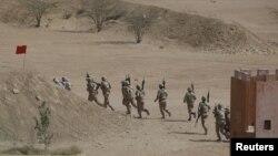 Lính biệt kích Pakistan trong một cuộc huấn luyện chống khủng bố ở ngoại ô Karachi, Pakistan, ngày 24 tháng 2 năm 2015.
