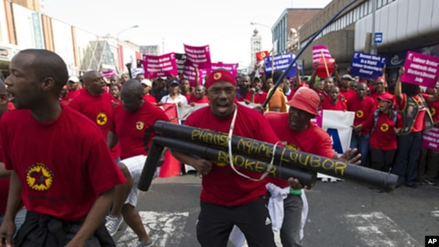 Striking workers belonging to unions under the Congress of South African Trade Unions march through Durban, July 12, 2011