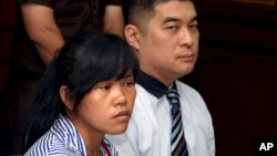 FILE - Philippine national Mary Jane Veloso, left, who is on death row for drug offences, accompanied by an unidentified interpreter, attends her judicial review hearing at Sleman District Court in Yogyakarta, Indonesia, March 4, 2015.
