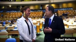 "Secretary-General Ban Ki-moon speaks with Beyoncé Knowles, an American singer and songwriter, August 9, 2012, during rehearsals in the General Assembly Hall for the recording of the song, ""I Was Here,"" in front of a live audience."