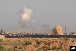 Smoke billows through the air during an offensive by Iraqi military forces into Fallujah to retake the city from Islamic State militants in Iraq, May 30, 2016.