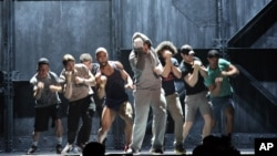 "Andy Karl, center, performs with the cast of ""Rocky: The Musical,"" during a rehearsal for the Tony Awards at Radio City Music Hall in New York, June 6, 2014."