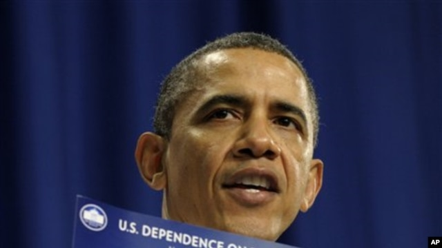 President Barack Obama holds up a chart as he speaks about his energy policies March 1, 2012 in Nashua, New Hampshire.
