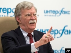 U.S. National security adviser John Bolton gestures while speaking to the media after his talks with Russian President Vladimir Putin in Moscow, Russia, June 27, 2018.