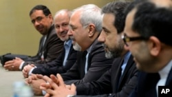 Iranian Foreign Minister Mohammad Javad Zarif, center, attends talks on Iran's nuclear program in Geneva on Nov. 22, 2013.