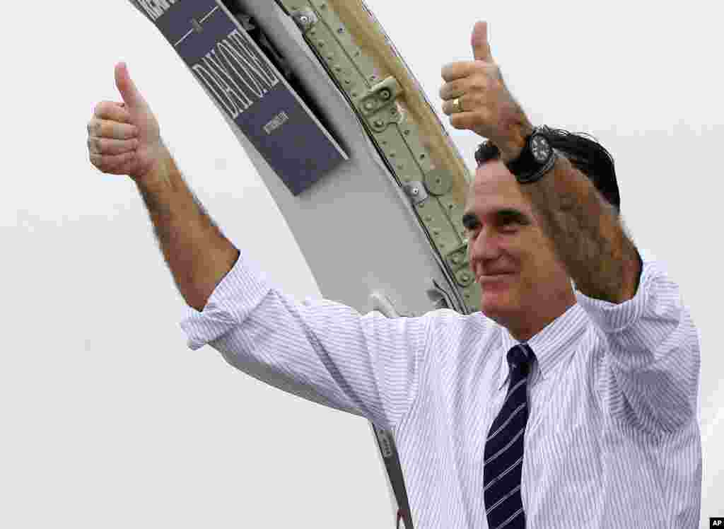Republican presidential candidate, former Massachusetts Gov. Mitt Romney gives two thumbs up as he boards his campaign plane to head to Virginia after a Florida campaign rally in Sanford, Nov. 5, 2012.