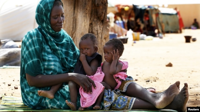 Malian family displaced by war gather at a makeshift camp in Sevare, about 400 miles northeast of Bamako, July 11, 2012.