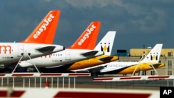 FILE - EasyJet planes are seen standing on the tarmac of Britain's Luton Airport.
