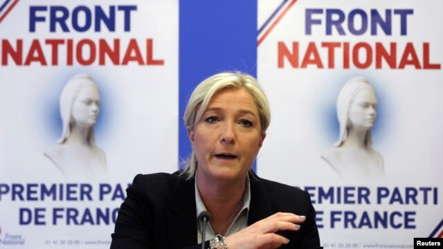 FILE - Marine Le Pen, France's National Front political party head, attends a news conference at the party's headquarters in Nanterre, near Paris, May 27, 2014.