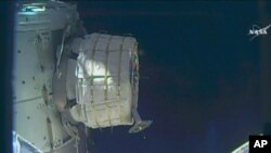 In this frame from NASA TV, a new experimental room at the International Space Station partially inflates Thursday, May 26, 2016.