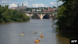 People kayak on the Potomac River near the Georgetown neighborhood and Theodore Roosevelt Island in Washington,