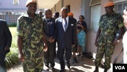 Former Malawi President Bakili Muluzi, center, is pictured outside the High Court in Blantyre. (L. Masina/VOA)