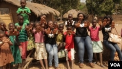 FILE: Girls in central Malawi protest child abuse and early marriage. (L. Masina/VOA)
