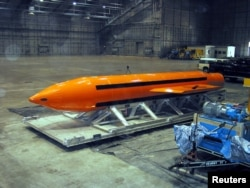 A Massive Ordnance Air Blast (MOAB) weapon is prepared for testing at the Eglin Air Force Armament Center on March 11, 2003.