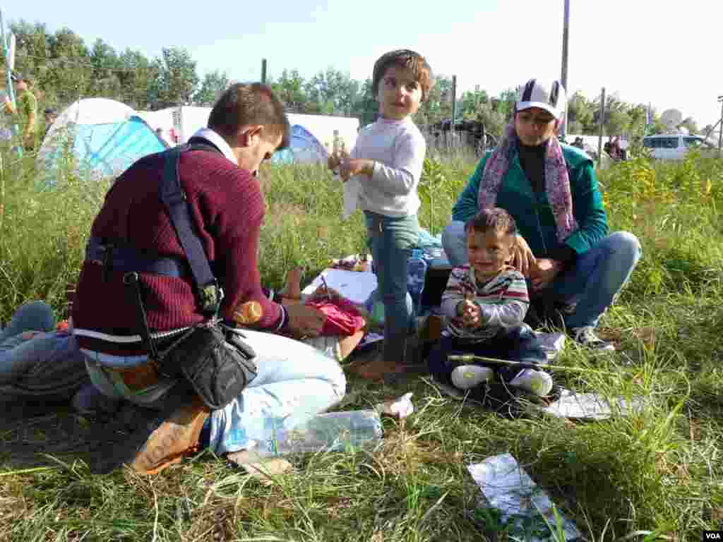Thousands of migrants poured into Croatia on Thursday, setting up a new path toward western Europe after Hungary used tear gas and water cannon to keep them out of its territory. Here, a Syrian refugee family takes a rest, at Horgos, Serbia, Sept. 15, 2015. (Henry Ridgwell/VOA)
