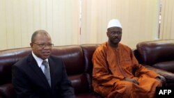 Mali's first post-war prime minister Oumar Tatam Ly (R) took over on September 6, 2013 from former interim Prime Minister Diango Cissoko (L) at a ceremony in Bamako.