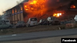 A Zimbabwe Revenue Authority warehouse burns in Beitbridge near the South African border.