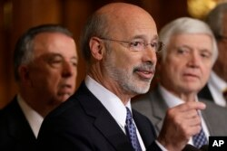 FILE - Pennsylvania Gov. Tom Wolf, center, discusses state budget negotiations at the state Capitol in Harrisburg, Pa., Oct. 7, 2015.