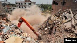 Last standing part of Rana Plaza collapses during army rescue operation in Savar, Bangladesh, May 2, 2013.