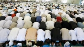 Muslims pray during Eid al Fitr prayer marking end of Ramadan in southern France, Aug. 19, 2012