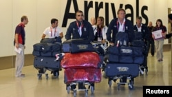 Members of the Italian Olympic squad arrive at Heathrow airport, London, England, July 16, 2012.