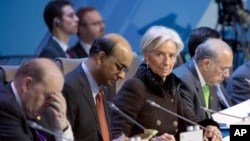 Chief of the International Monetary Fund, Christiane Lagarde, secont right, attends the summit of financial ministers and heads of central banks of the G20 group of nations in Moscow, Russia, February 16, 2013.