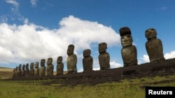 FILE - Statues named moai are seen on a hill at the Easter Island, Chile January 31, 2019. (REUTERS/Jorge Vega/File Photo)