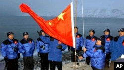 FILE - The Chinese national flag is raised in Longyearbyen on Svalbard, Norway, to set the site of a Chinese research station, Oct. 31, 2001. A new State Department report highlights the recent expansion of China's activities in the Arctic.