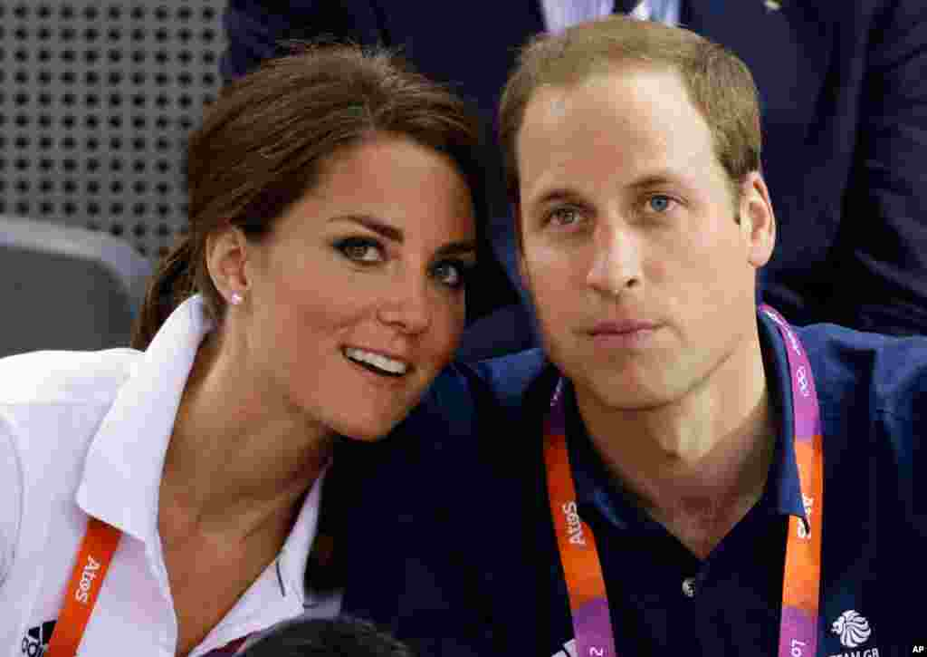Prince William and his wife Kate watch track cycling at the velodrome.