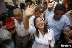 FILE - Peruvian presidential candidate Keiko Fujimori greets supporters at Cerro San Cosme on the outskirts of Lima, Jan. 8, 2016.