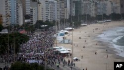 People march during an anti-government protest at the Copacabana beach, in Rio de Janeiro, Brazil, June 23, 2013.