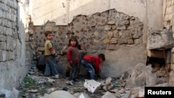 Children play in the old city of Aleppo, Syria, Feb. 4, 2014.