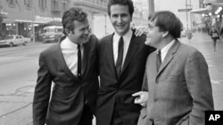 "The Kingston Trio - Bob Shane, left, John Stewart, center, and Nick Reynolds, right, poses in Hollywood in 1967 after announcing they are giving up the act. Their reason: the public won't let them sing anything but ""Tom Dooley."""