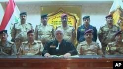 伊拉克总理(中)在电视上宣布对摩苏尔的攻势开始