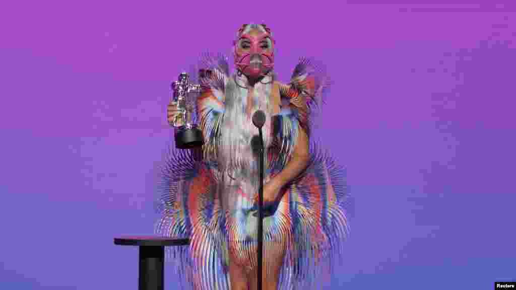 "Lady Gaga accepts the award for Best Collaboration for ""Rain On Me"" during the 2020 MTV VMAs in this screen grab image made available on Aug. 30, 2020. (VIACOM/Handout)"