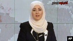 Egypt State TV, Fatma Nabil reads out the headlines wearing a headscarf on the noon news bulletin on state television in Cairo, Egypt, Sept. 3, 2012.