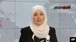 Pembawa berita di stasiun televisi pemerintah Mesir, Fatma Nabil. (Foto: AP/Egypt State TV)