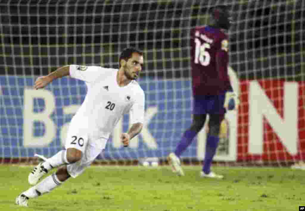 "Libya's Ihab Al Bouseffi celebrates after scoring a goal against Senegal during their African Nations Cup Group A soccer match at Estadio de Bata ""Bata Stadium"", in Bata January 29, 2012."