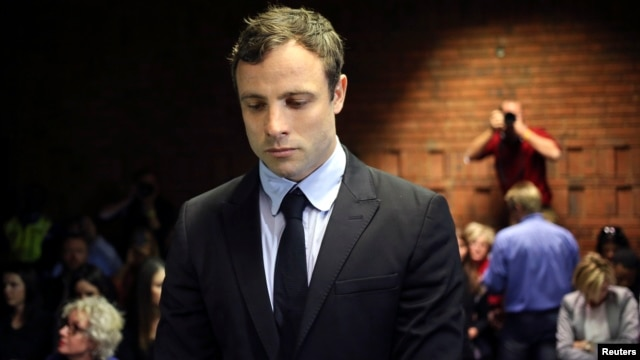 Olympic and Paralympic running star Oscar Pistorius stands during court proceedings at the Pretoria Magistrates court, August 19, 2013.