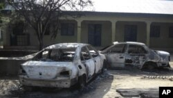 Burnt-out cars are seen at the business and skills center following attacks by the Boko Haram sect in Potiskum, Nigeria, October 20, 2012.