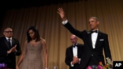 FILE - Then-President Barack Obama waves after speaking at the annual White House Correspondents' Association dinner at the Washington Hilton, April 30, 2016. President Donald Trump says he'll be skipping the dinner this year.